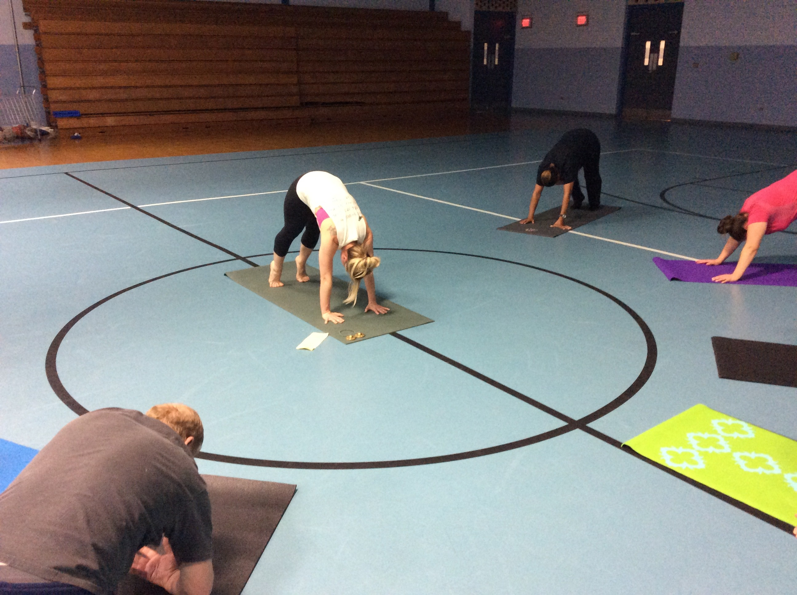 Adults doing yoga