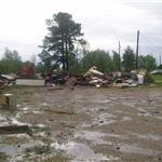 Debris pushed into dirt field during the storm.