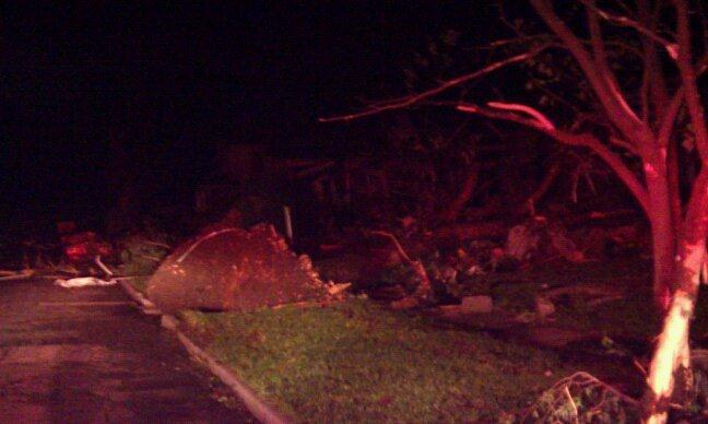 Night time image of trees pushed down, tearing ground up with its roots.
