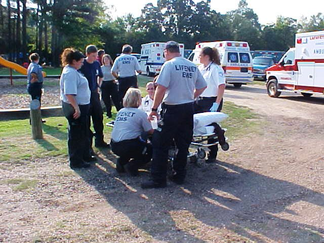 Emergency personnel on stand by with a stretcher.