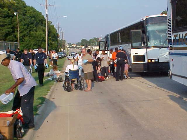 People arriving by bus to Hurricane Katrina shelters.